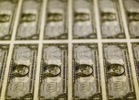 FILE PHOTO: United States one dollar bills seen on a light table at the Bureau of Engraving and Printing in Washington