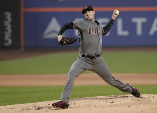 Arizona Diamondbacks pitcher Patrick Corbin delivers against the New York Mets during the first inning of a baseball game, Saturday, May 19, 2018, in New York. (AP Photo/Julie Jacobson)