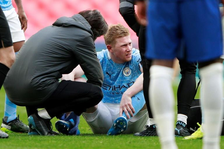 Injured: Manchester City's Kevin De Bruyne receives medical attention