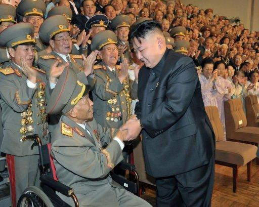 North Korean leader Kim Jong-Un (R) meets with veterans in Pyongyang