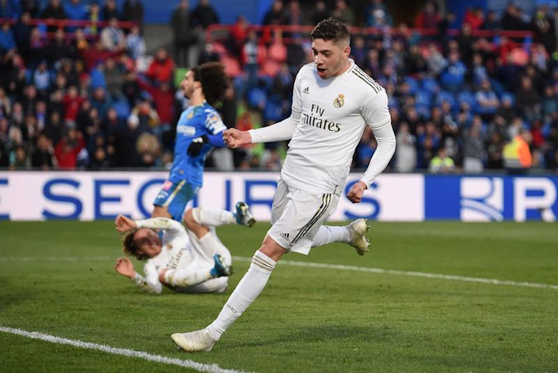 GETAFE, SPAIN - JANUARY 04: Federico Valverde of Real Madrid celebrates after teammate Luka Modric scored his team's third goal during the La Liga match between Getafe CF and Real Madrid CF at Coliseum Alfonso Perez on January 04, 2020 in Getafe, Spain. (Photo by Denis Doyle/Getty Images)