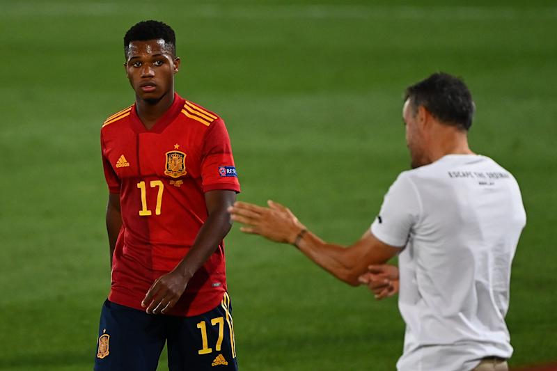 Spain's coach Luis Enrique (R) gives instructions to Spain's forward Ansu Fati during the UEFA Nations League A group 4 football match between Spain and Ukraine at the Alfredo Di Stefano Stadium in Madrid on September 6, 2020. (Photo by GABRIEL BOUYS / AFP) (Photo by GABRIEL BOUYS/AFP via Getty Images)