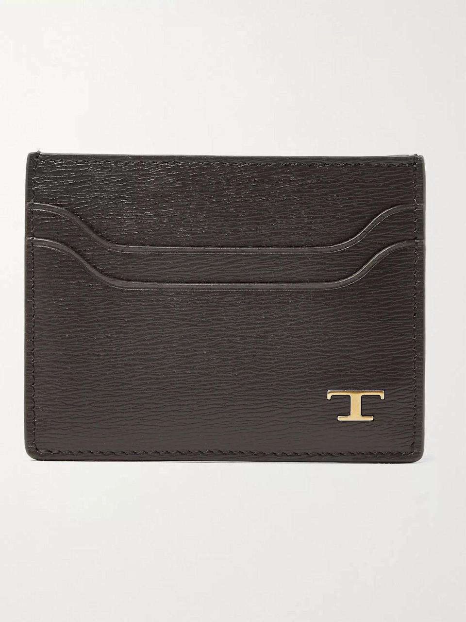 """<p><strong>Tod's</strong></p><p>mrporter.com</p><p><strong>$245.00</strong></p><p><a href=""""https://go.redirectingat.com?id=74968X1596630&url=https%3A%2F%2Fwww.mrporter.com%2Fen-us%2Fmens%2Fproduct%2Ftods%2Faccessories%2Fcardholders%2Ftextured-leather-cardholder%2F24092600056620274&sref=https%3A%2F%2Fwww.esquire.com%2Fstyle%2Fmens-accessories%2Fg35924710%2Fmens-luxury-wallets%2F"""" rel=""""nofollow noopener"""" target=""""_blank"""" data-ylk=""""slk:Shop Now"""" class=""""link rapid-noclick-resp"""">Shop Now</a></p><p>Masterful Italian minimalism, courtesy of a brand that made it a signature. </p>"""