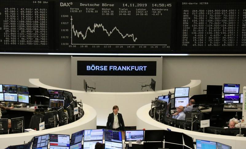 European stocks end flat as defensive gains offset auto slide