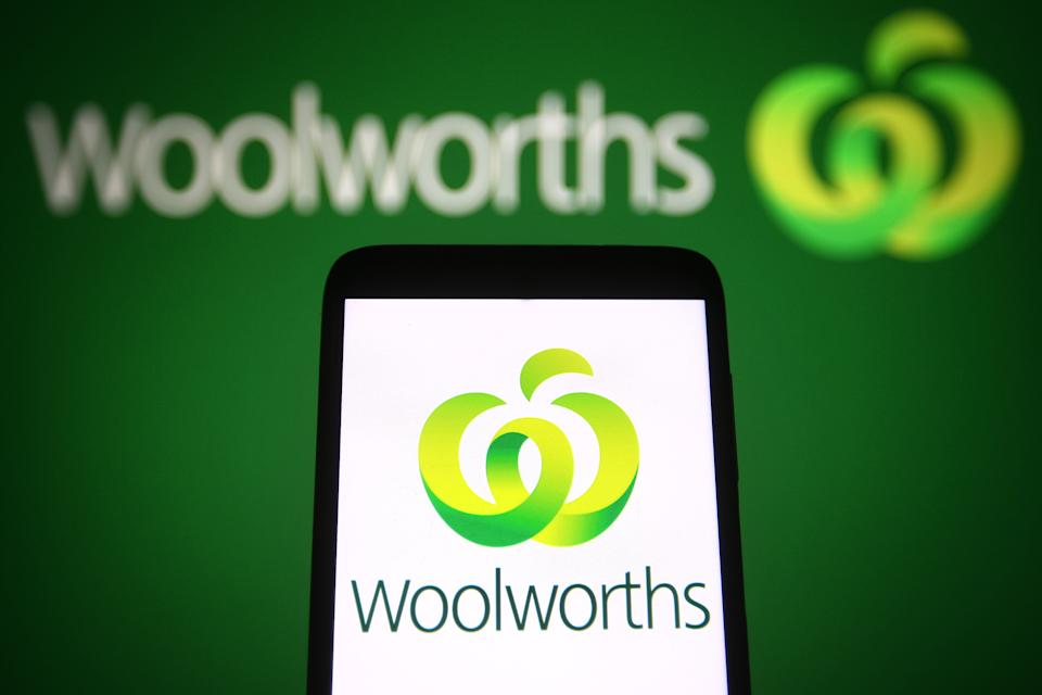 Woolworths icon on phone in front of Woolworths storefront logo. Source: Getty Images