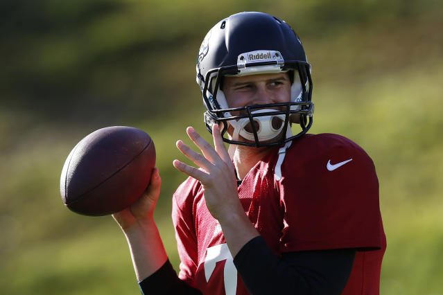 Jacksonville Jaguars' quarterback Chad Henne throws a ball during their football practice at the Pennyhill Park Hotel and Spa in Bagshot, England, Wednesday, Oct. 23, 2013. The Jaguars face the San Francisco 49ers on Sunday in a NFL football game at Wembley Stadium in London. (AP Photo/Sang Tan)