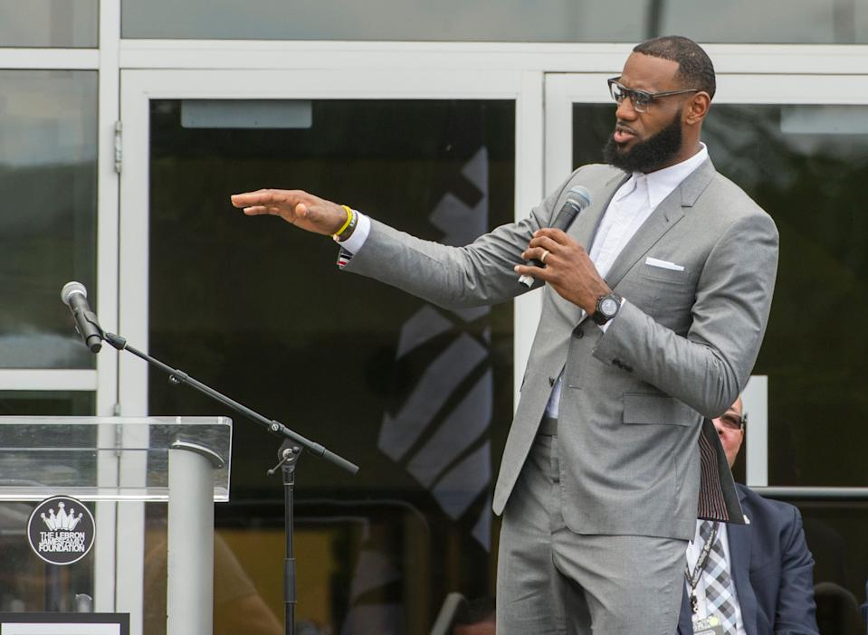 LeBron James speaks at the opening ceremony for the I Promise School in Akron, Ohio, Monday, July 30, 2018. The I Promise School is supported by the The LeBron James Family Foundation and is run by the Akron Public Schools. (AP Photo/Phil Long)