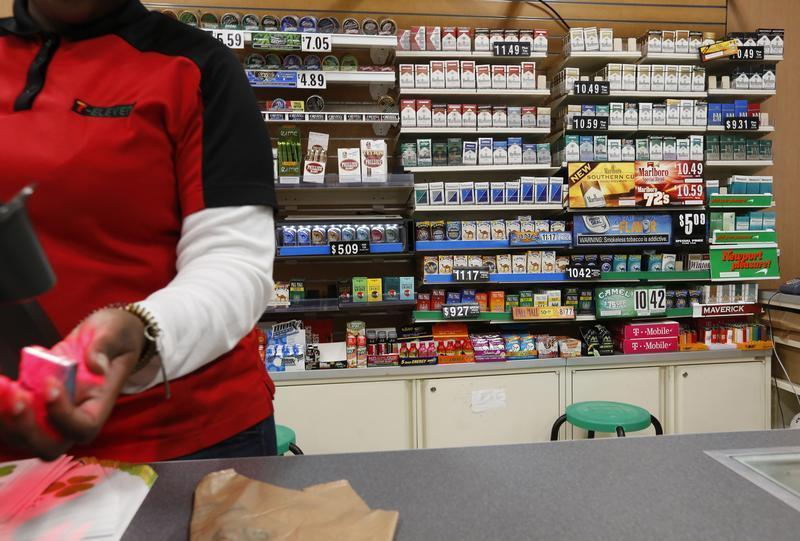 Cigarettes are displayed behind the counter of a convenient store in New York