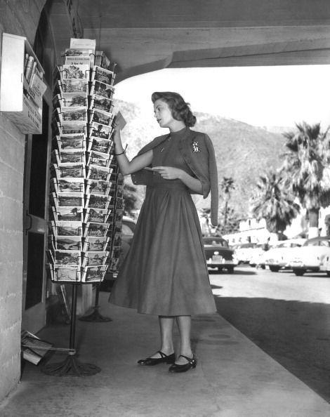 <p>Movie star Grace Kelly, known for Alfred Hitchcock's <em>Rear Window</em> and <em>Dial M for Murder</em>, browses the postcard rack on a sunny day in 1954. Merely two years later she would go on to become Princess of Monaco after marrying Prince Rainier III.</p>