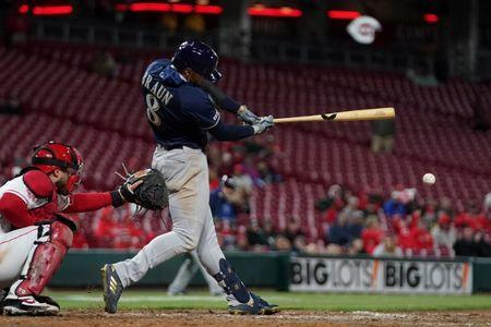 Apr 1, 2019; Cincinnati, OH, USA; Milwaukee Brewers left fielder Ryan Braun (8) hits an RBI double against the Cincinnati Reds in the ninth inning at Great American Ball Park. Mandatory Credit: Aaron Doster-USA TODAY Sports