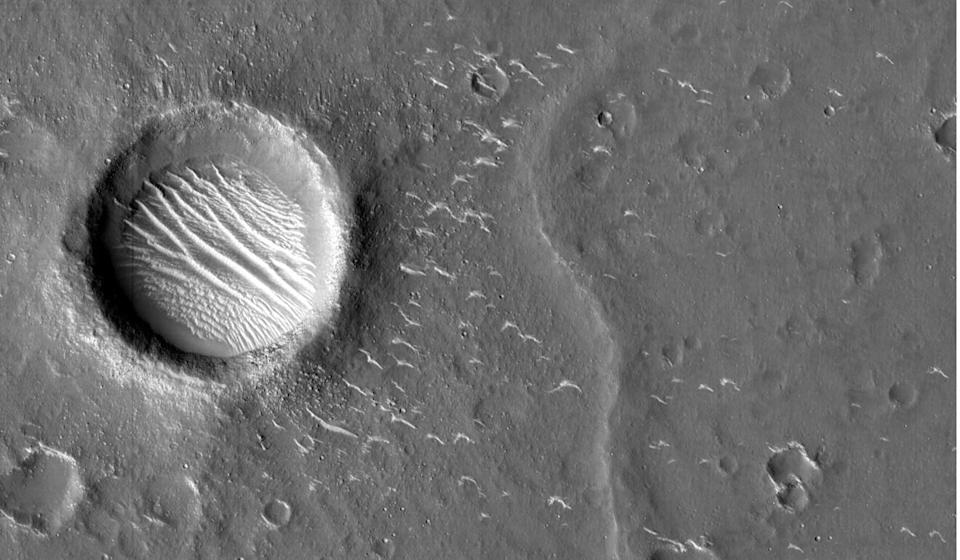 An image of Mars taken by China's Tianwen-1 shows fine ridges on the bottom of a crater. Photo: Reuters/CNSA