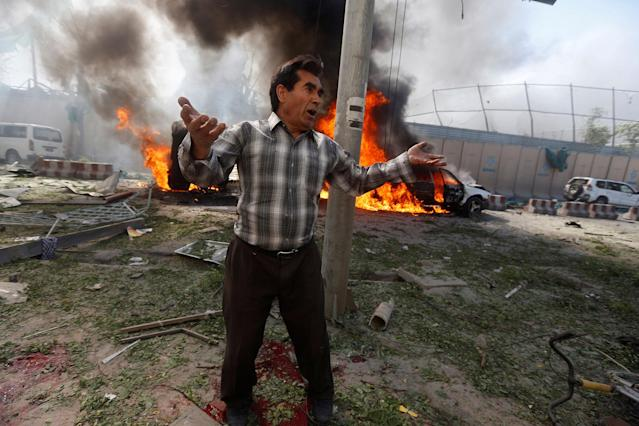 <p>An Afghan man reacts at the site of a blast in Kabul, Afghanistan May 31, 2017. (Omar Sobhani/Reuters) </p>