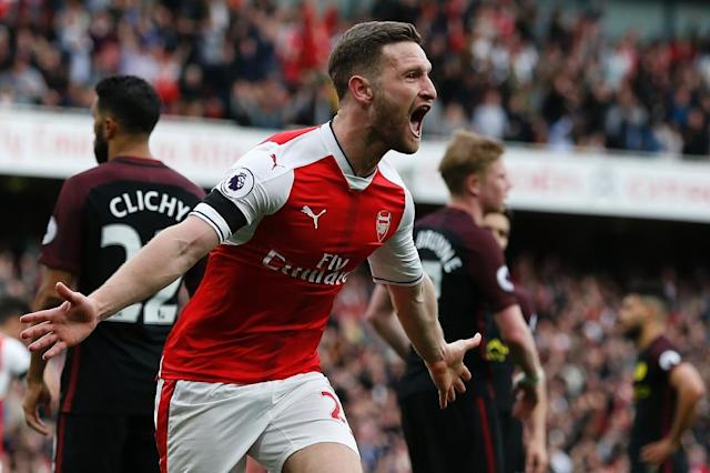 Arsenal's Shkodran Mustafi celebrates after scoring against Manchester City during a Premier League match at The Emirates stadium in London, on April 2, 2017 (AFP Photo/Ian KINGTON)