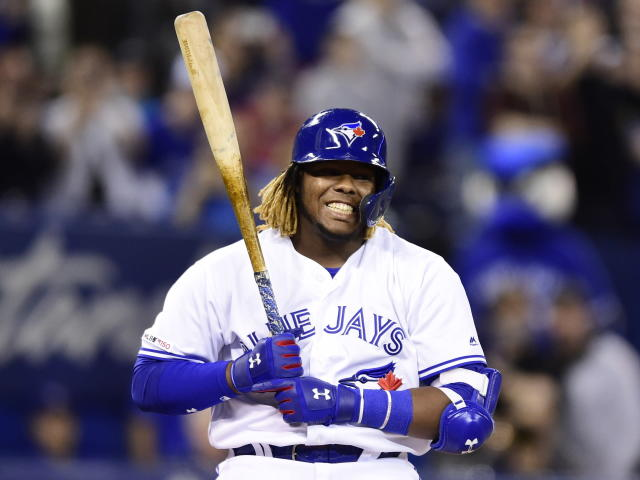 Toronto Blue Jays third baseman Vladimir Guerrero Jr. reacts to a strike call during his first at-bat during second-inning baseball game action against the Oakland Athletics in Toronto, Friday, April 26, 2019. (Frank Gunn/The Canadian Press via AP)