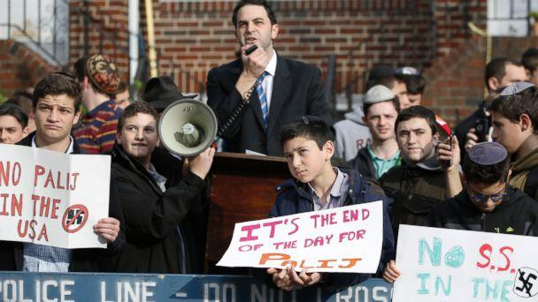 Hillel Goldman, associate principal of the Orthodox Jewish Rambam Mesivta High School, speaks as he and students from the school protest former Nazi concentration camp guard Jakiw Palij, 94, Thursday, Nov. 9, 2017, in Jackson Heights, New York. (AP)
