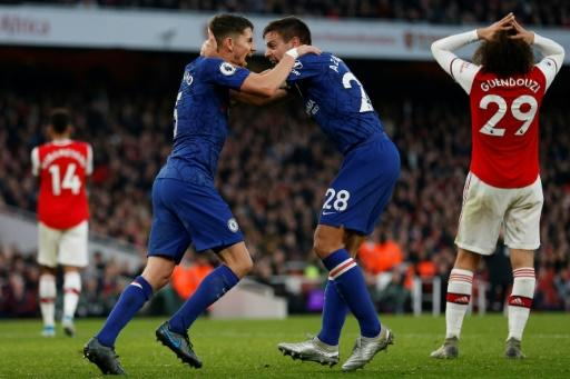 Jorginho (left) celebrates after equalising for Chelsea against Arsenal
