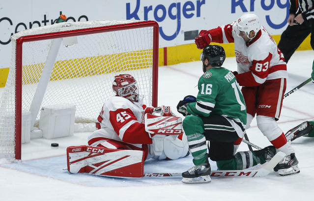 Dallas Stars forward Joe Pavelski (16) and Detroit Red Wings defenseman Trevor Daley (83) look on as the puck slips past goaltender Jonathan Bernier (45) during the third period of an NHL hockey game Friday, Jan. 3, 2020, in Dallas. Upon video review the goal was disallowed due to goaltender interference. (AP Photo/Brandon Wade)