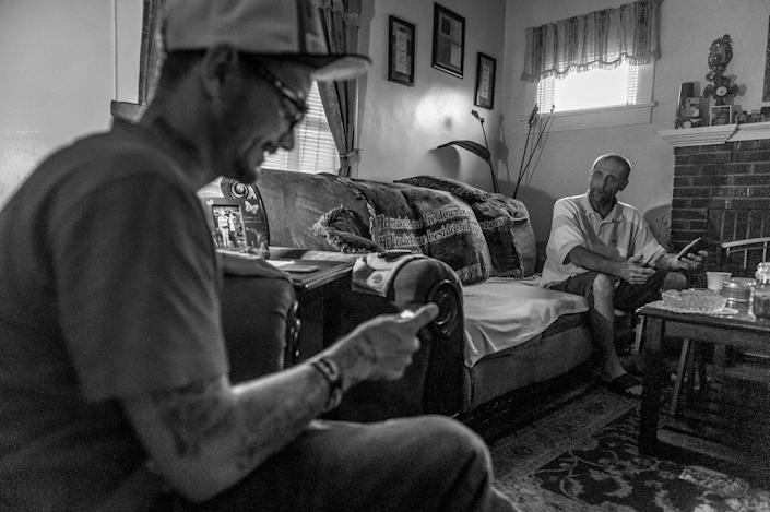 <p>Gene Robinson, right, a recovering heroin addict, with his fiancée's son, Larry Fugate, left – also a recovering addict. (Photograph by Mary F. Calvert for Yahoo News) </p>