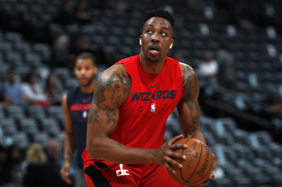Injured Washington Wizards center Dwight Howard practices before the Wizards face the Denver Nuggets in the first half of an NBA basketball game Sunday, March 31, 2019, in Denver. (AP Photo/David Zalubowski)