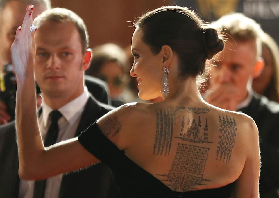 The stories they tell - Angelina Jolie shows off her tattoos.