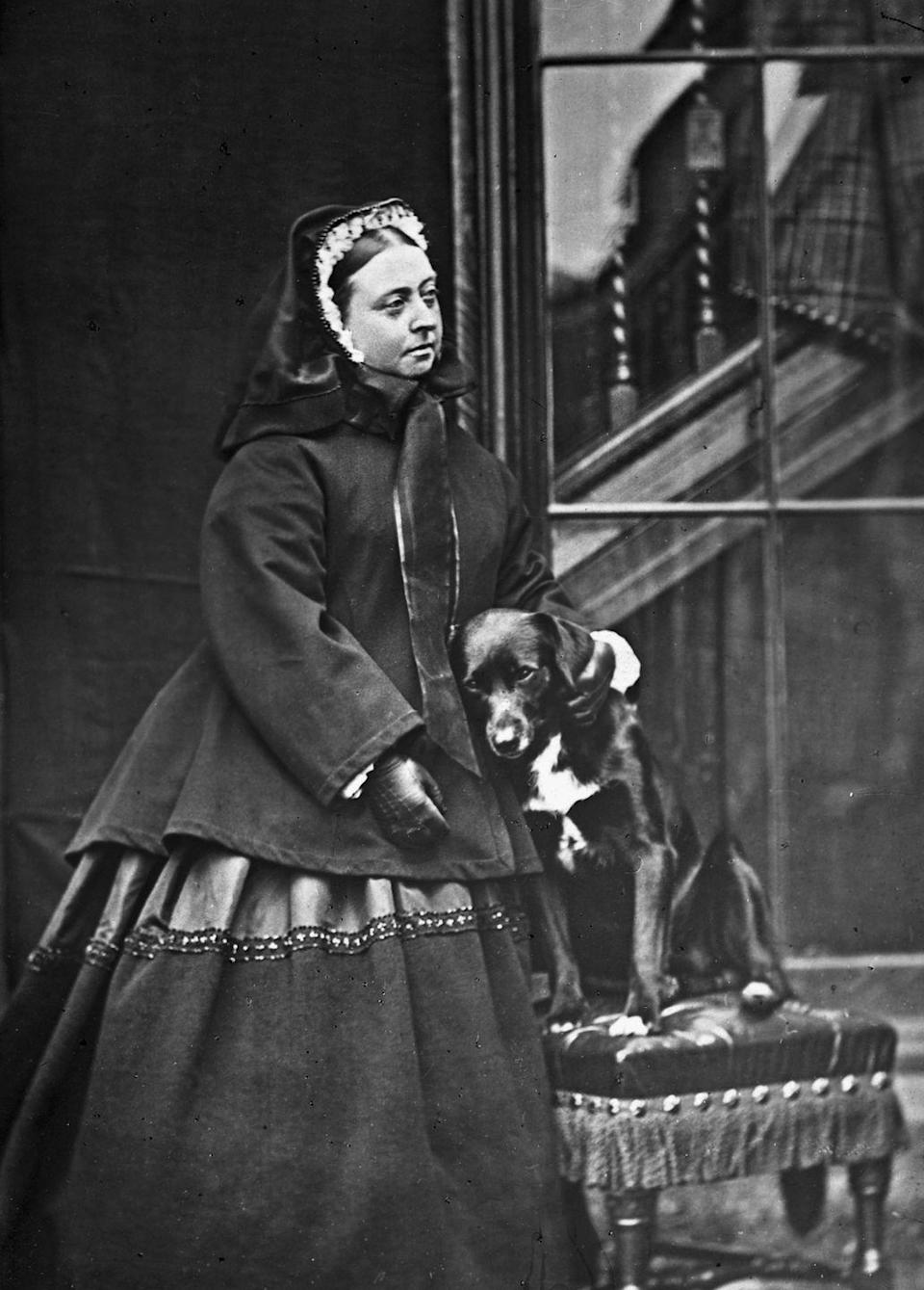 <p>Queen Victoria poses with her dog at Balmoral.</p>