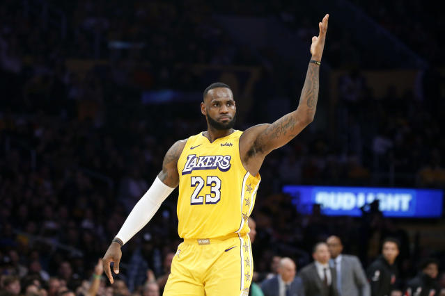 Los Angeles Lakers' LeBron James reacts after making a 3-pointer during the second half of the team's NBA basketball game against the Los Angeles Clippers on Wednesday, Dec. 25, 2019, in Los Angeles. The Clippers won 111-106. (AP Photo/Ringo H.W. Chiu)