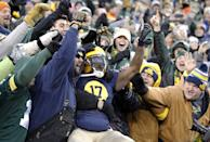 Green Bay Packers' Davante Adams celebrates with fans after catching a touchdown pass during the first half of an NFL football game against the Philadelphia Eagles Sunday, Nov. 16, 2014, in Green Bay, Wis. (AP Photo/Mike Roemer)