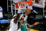 Dallas Mavericks' Willie Cauley-Stein (33) goes to the basket while defended by Los Angeles Lakers' Montrezl Harrell (15) during the first half of an NBA basketball game Friday, Dec. 25, 2020, in Los Angeles. (AP Photo/Ringo H.W. Chiu)