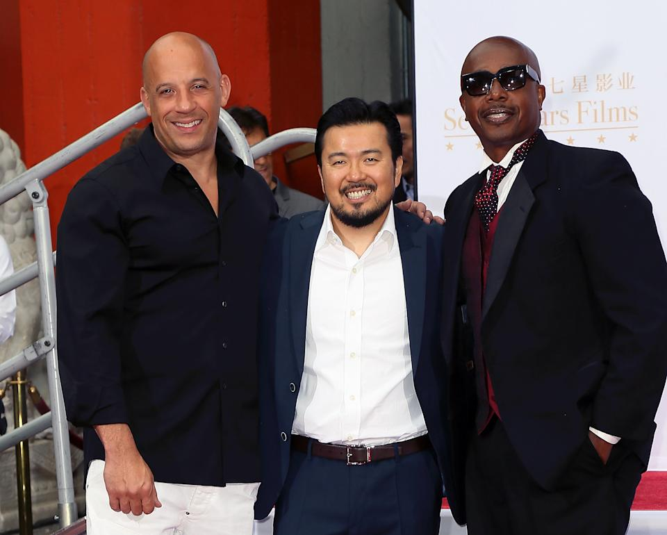 HOLLYWOOD, CA - JUNE 03:  (L-R) Actor Vin Diesel, director Justin Lin and rapper MC Hammer attend the Hand and Footprint Ceremony for Justin Lin, Zhao Wei and Huang Xiaoming at the TCL Chinese Theatre IMAX on June 3, 2015 in Hollywood, California.  (Photo by David Livingston/Getty Images)