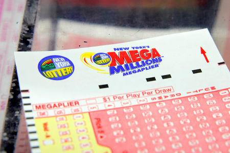 A ticket is seen ahead of the Mega Millions lottery draw which reached a jackpot of $415 Million in Manhattan, New York, U.S.