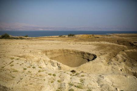 A sinkhole is seen on the shore of the Dead Sea, Israel July 27, 2015. REUTERS/Amir Cohen