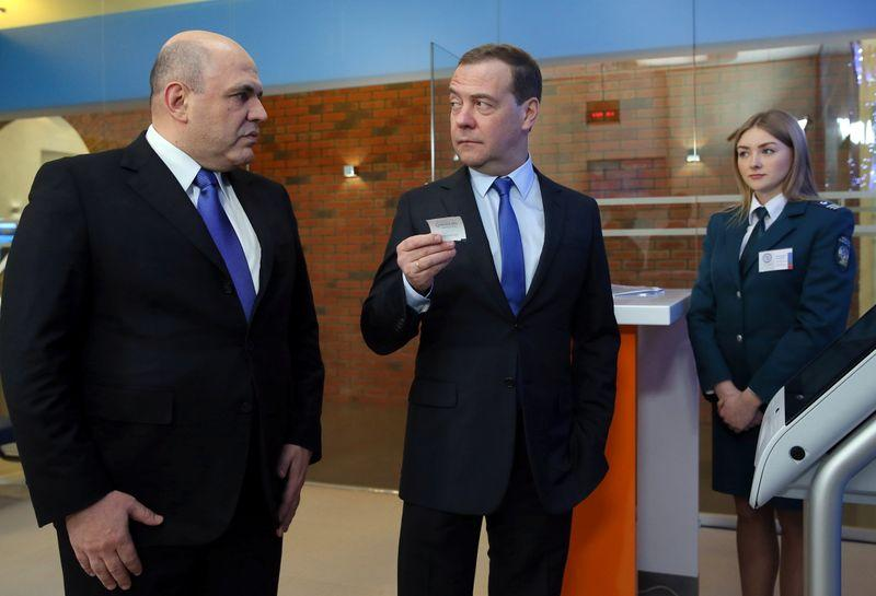 Russian Prime Minister Medvedev and head of the Federal Taxation Service Mishustin visit a tax office in Moscow