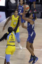 Minnesota Lynx forward Napheesa Collier (24) shoots over Chicago Sky guard Kahleah Copper (2) and forward Gabby Williams (15) during the first half of a WNBA basketball game Thursday, July 30, 2020, in Bradenton, Fla. (AP Photo/Chris O'Meara)