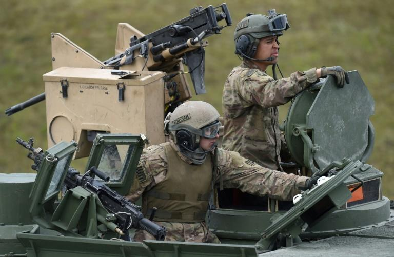 The move will cut the current US troop level in Germany from about 34,500 to 25,000, President Donald Trump's stated goal (US troops pictured near Grafenwoehr, Germany in 2017) (AFP Photo/Christof STACHE)