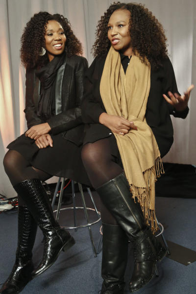 "In this Wednesday, Feb. 6, 2013 photo, Swati Dlamini, left, and Zaziwe Dlamini-Manaway, granddaughters of Nelson and Winnie Mandela, speak during an interview in New York. The sisters are stars of the new reality show ""Being Mandela,"" produced by COZI TV for NBC. The 30-minute weekly show premieres on Sunday, Feb. 10 at 9 PM ET and will follow the next generation of Mandela family through the experiences of sisters Zaziwe and Swati and their families. (AP Photo/Bebeto Matthews)"