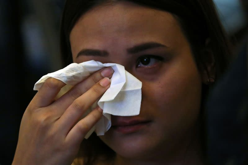 Victim's family member wipes her tears during the sixth annual remembrance event for the missing Malaysia Airlines flight MH370 in Putrajaya