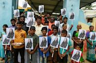 Children waved pictures of their hero in the streets