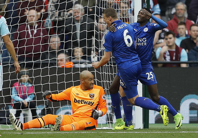 <p>Leicester's Robert Huth, center, celebrates after scoring his side's second goal of the game, during the English Premier League soccer match between West Ham and Leicester City at London Stadium in London, Saturday, March 18, 2017. (AP Photo/Frank Augstein) </p>