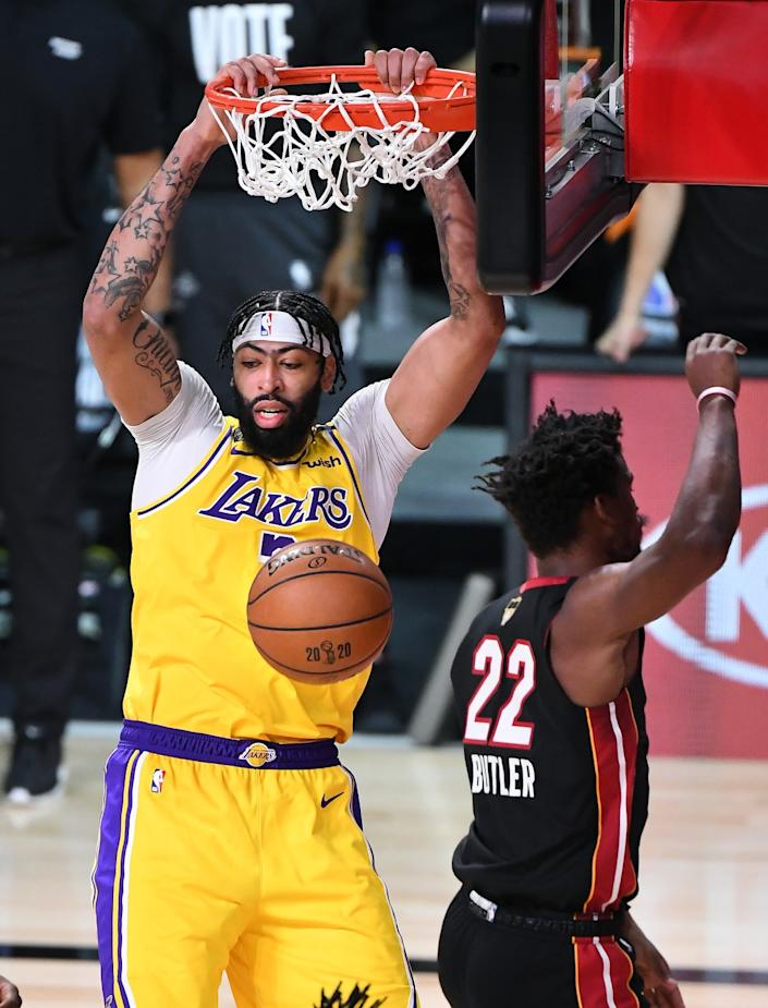 Lakers forward Anthony Davis dunks after a feed from Kyle Kuzma (not pictured) during Game 1.