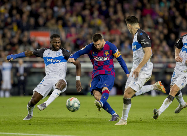 Barcelona's Lionel Messi scores a goal during a Spanish La Liga soccer match between Barcelona and Alaves at Camp Nou stadium in Barcelona, Spain, Saturday, Dec. 21, 2019. (AP Photo/Joan Monfort)