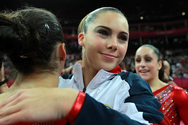 LONDON, ENGLAND - JULY 31: Mc Kayla Maroney hugs teammate Alexandra Raisman of the United States during the Artistic Gymnastics Women's Team final on Day 4 of the London 2012 Olympic Games at North Greenwich Arena on July 31, 2012 in London, England. (Photo by Ronald Martinez/Getty Images)