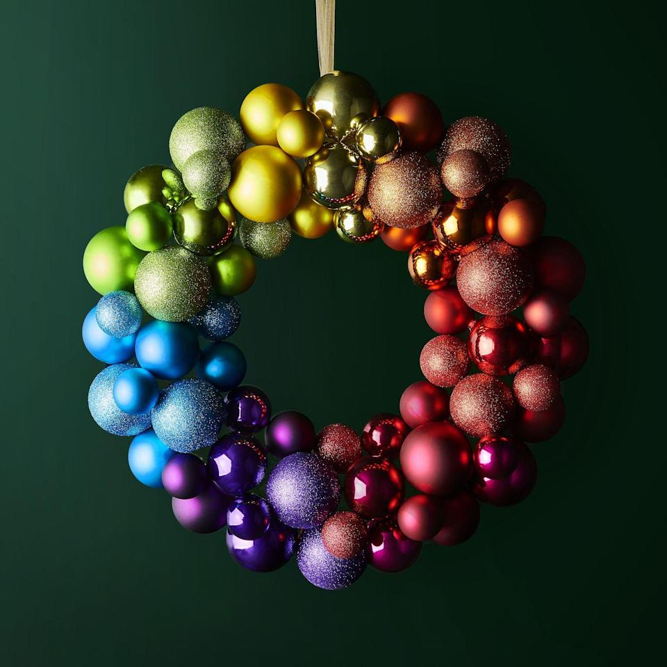 <p>If you can't be bold with decorating during Christmas, then when can you be? 'This eye-catching, rainbow-coloured shatterproof bauble wreath will be a firm family favourite,' say Waitrose.</p>