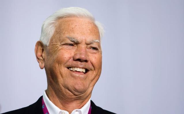 NASCAR Hall of Fame inductee Junior Johnson smiles while speaking during the grand opening of the NASCAR Hall of Fame in Charlotte