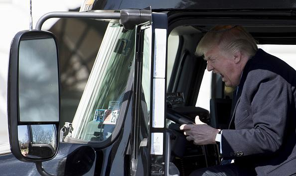 US President Donald Trump sits in the driver's seat of a semi-truck as he welcomes truckers and CEOs to the White House in Washington, DC (JIM WATSON/AFP/Getty Images)