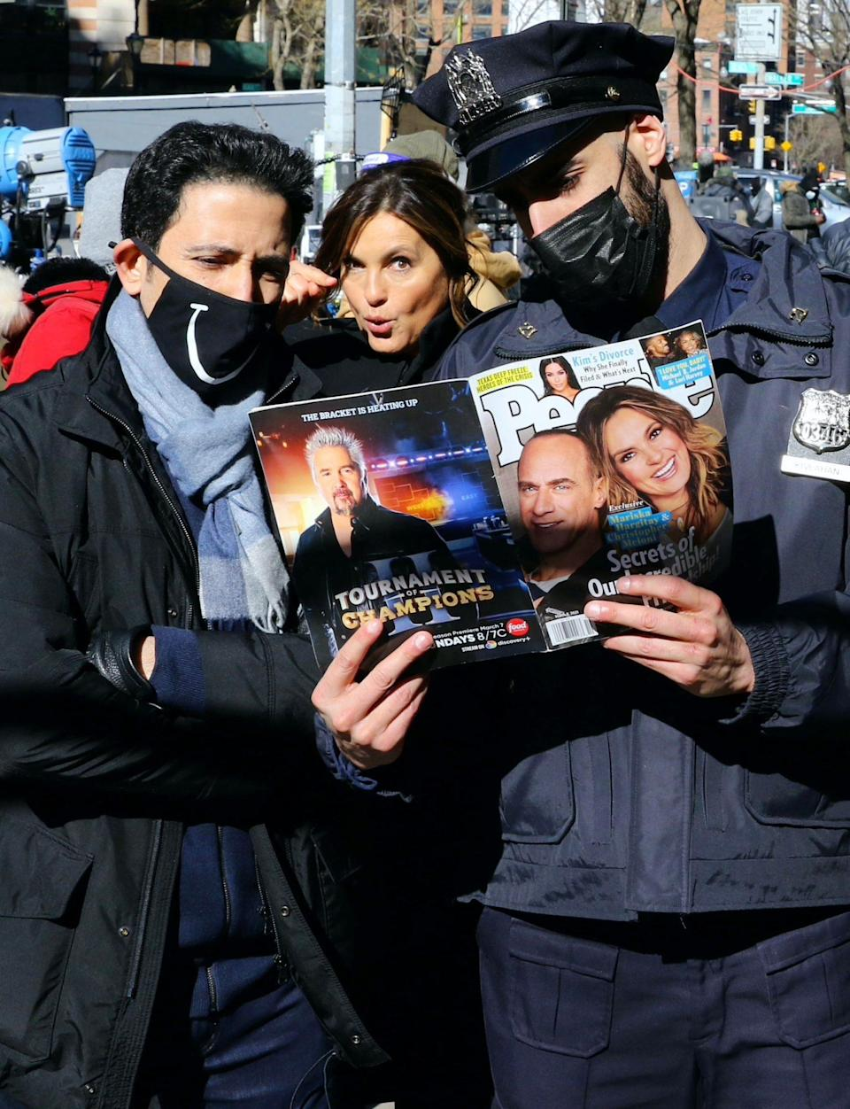 <p>Mariska Hargitay checks out her and Christopher Meloni's cover issue of PEOPLE while filming <em>Law & Order: Special Victims Unit </em>on Tuesday in N.Y.C. </p>