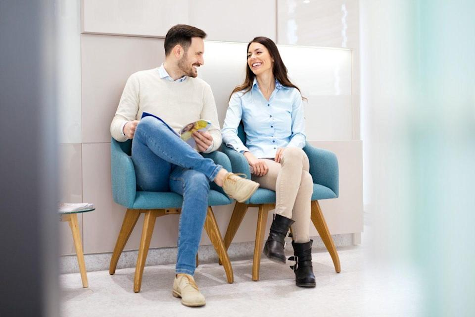 Couple talking in waiting room