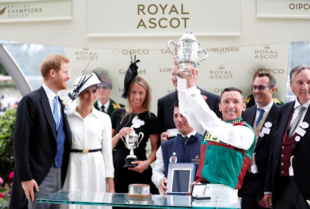 Horse Racing - Royal Ascot - Ascot Racecourse, Ascot, Britain - June 19, 2018 Frankie Dettori celebrates with a trophy after winning the 4.20 St James's Palace Stakes as Britain's Prince Harry and Meghan, the Duchess of Sussex look on Action Images via Reuters/Paul Childs