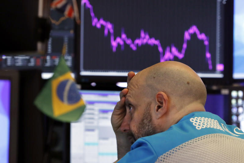 Specialist Meric Greenbaum works at his post on the floor of the New York Stock Exchange, Tuesday, Feb. 25, 2020. Stocks slumped and bond prices soared for the second day in a row as fears spread that the widening virus outbreak will put the brakes on the global economy. (AP Photo/Richard Drew)