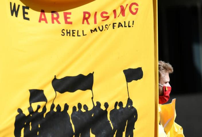Banner is pictured during a demonstration outside of the Shell headquarters, in The Hague