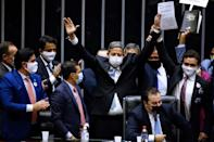 Brazilian Deputy Arthur Lira (C) celebrates after being elected as president of Brazil's Lower House in Brasilia on February 1, 2021